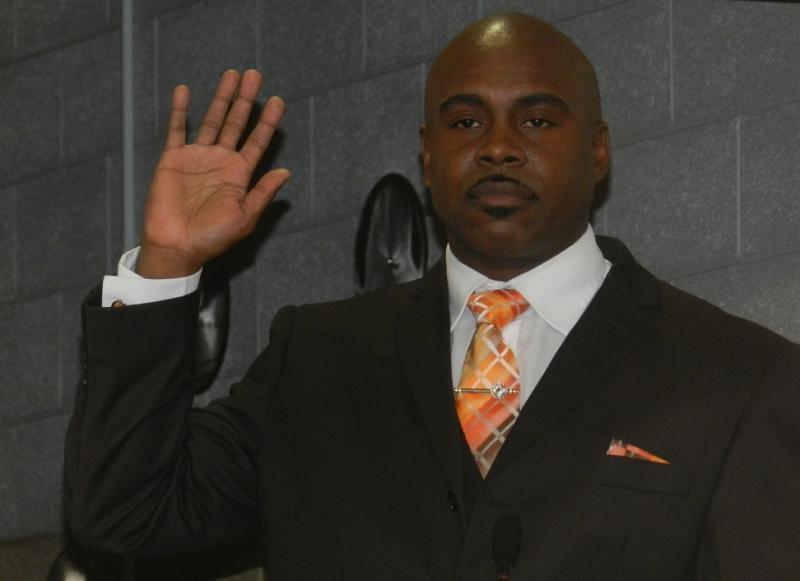 Fifth Ward Flint city councilman Wantwaz Davis taking his oath of office