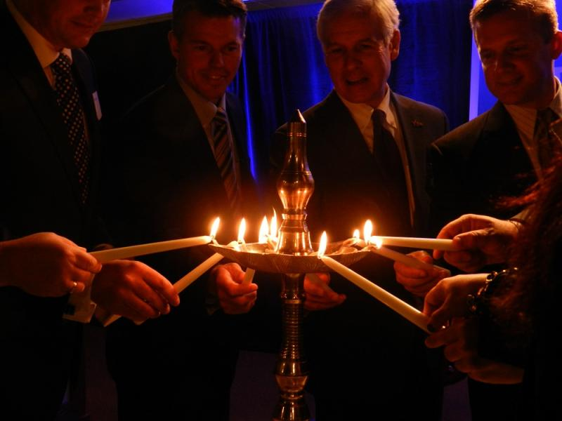 A group of local business and community leaders take part in a lamp lighting ceremony to celebrate the dedication of the new Michigan Technology Development Center in Jackson