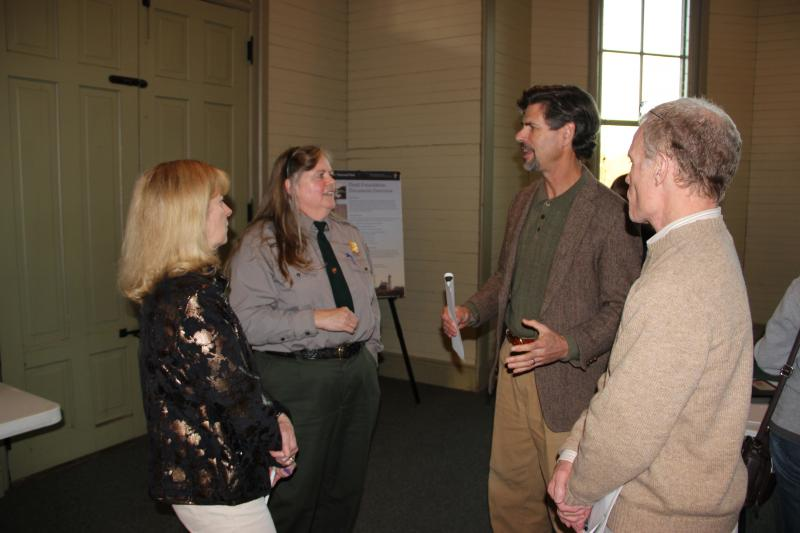 Isle Royale National Park Superindendent Phyllis Green talks with people at a public meeting in Chelsea, Michigan about the wolves on Isle Royale.