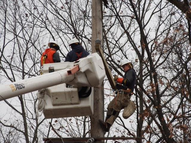 Utility crews work to restore electricity to tens of thousands of Michigan utility customers
