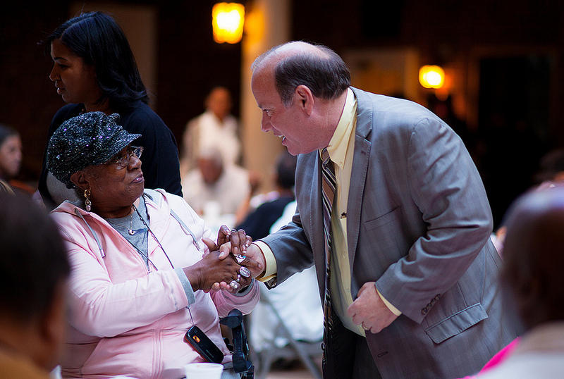 mayor mike duggan shaking woman's hand