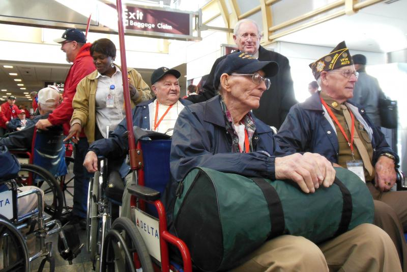 U.S. Senator Carl Levin greets veterans at Reagan National Airport in D.C.