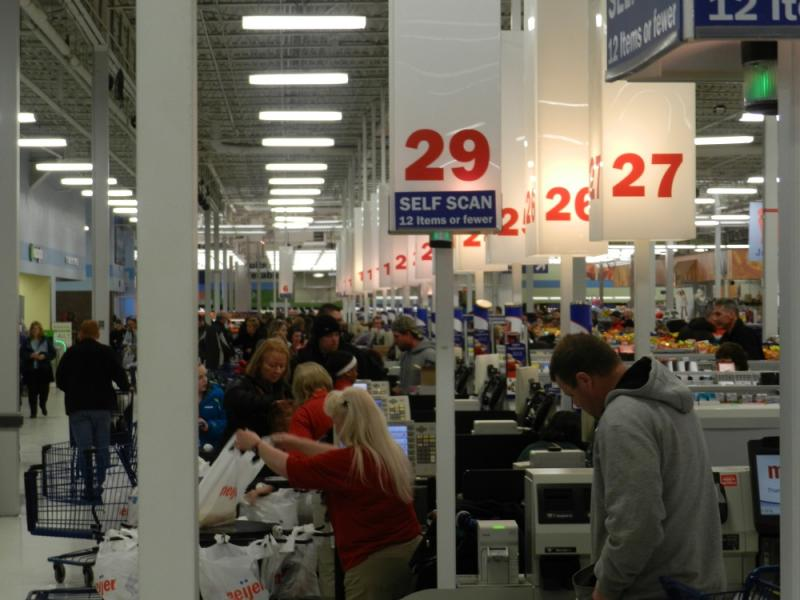 Christmas shoppers line up at cash registers on Christmas Eve