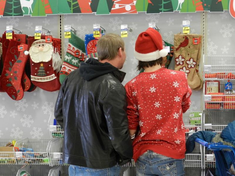Jeff Bycraft, and his fiancee Rachel Breton, shop for last minute Christmas presents at a Meijer store in Jackson, Michigan