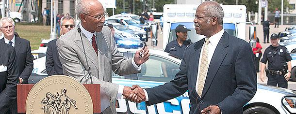 Detroit Mayor Dave Bing turns over the keys to a new EMS ambulance to Fire Commissioner Donald Austin. The vehicles -- 100 police cruisers and 23 ambulances -- were purchased with $8 million donated by the business community.