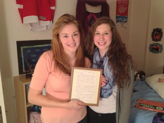 Kelly Rothe and her younger sister, Samantha. They're holding a letter written for Kelly by their mother before she died.