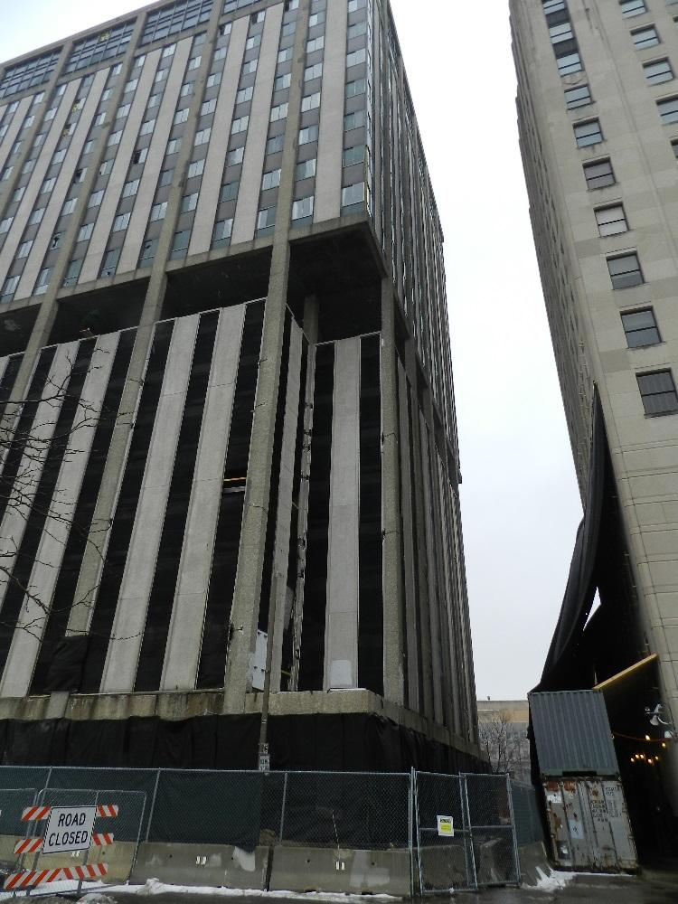 The 19 story Genesee Towers building is wired with explosives.  Crews have erected netting on other downtown Flint buildings to protect them from Sunday's collapse.