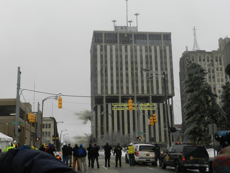 The Genesee Towers was first rocked by a series of powerful explosions inside the building.  Then, explosives blew out the buildings exterior supports