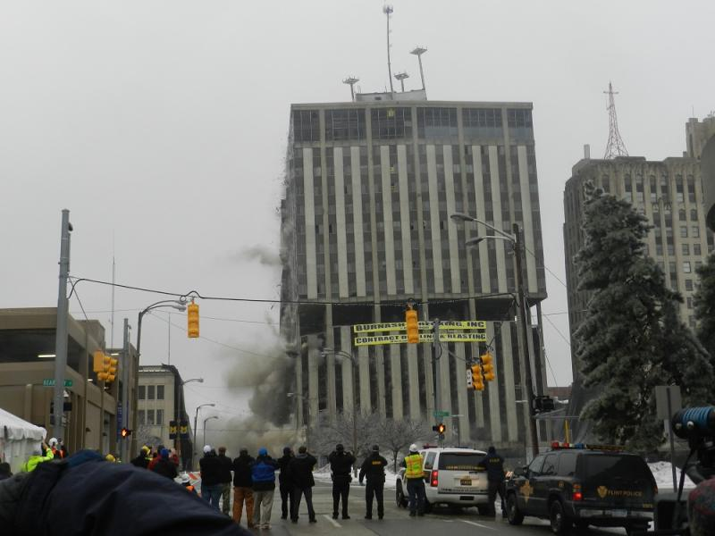 As the second round of explosions grew in intensity, the building started to buckle.