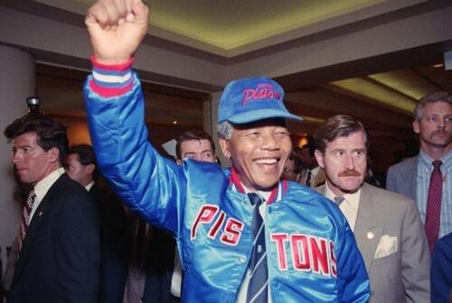 Nelson Mandela wearing Pistons gear given to him by some of the players at the time.