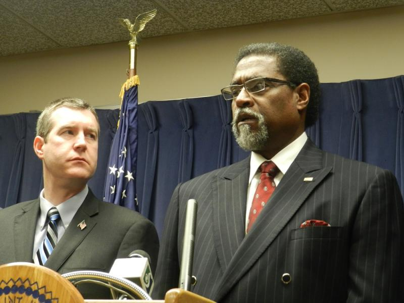 Flint Emergency Manager Darnell Earley (right) asked for councilman Eric Mays' resignation a week after the counciman was charged with DUI.   Flint Mayor Dayne Walling (left) also asked Mays to resign.