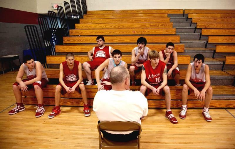 Assistant Coach Rudie Crain talks to the Medora team.