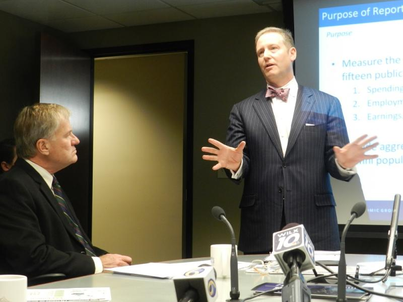 Patrick Anderson, of the Anderson Economic Group, reviews the numbers in the report.  Michigan Tech president Glenn Mroz (left) listens.
