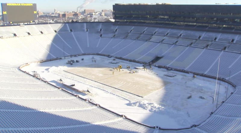 The ice rink being built in Michigan Stadium.