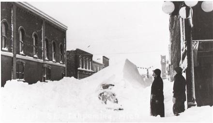 Yoopers saw snow pile around cars in the blizzard.