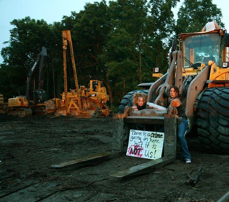This photo shows members of MI-Cats after they attached themselves to heavy equipment at the Enbridge pipeline construction worksite last July.