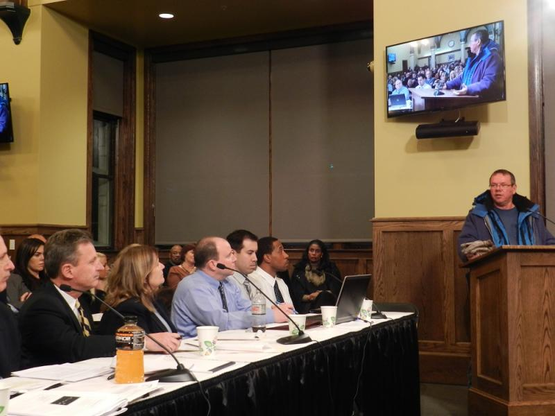 Lansing Board of Water and Light officials, including General Manager J. Peter Lark (far left), heard from critics and supporters alike during the meeting