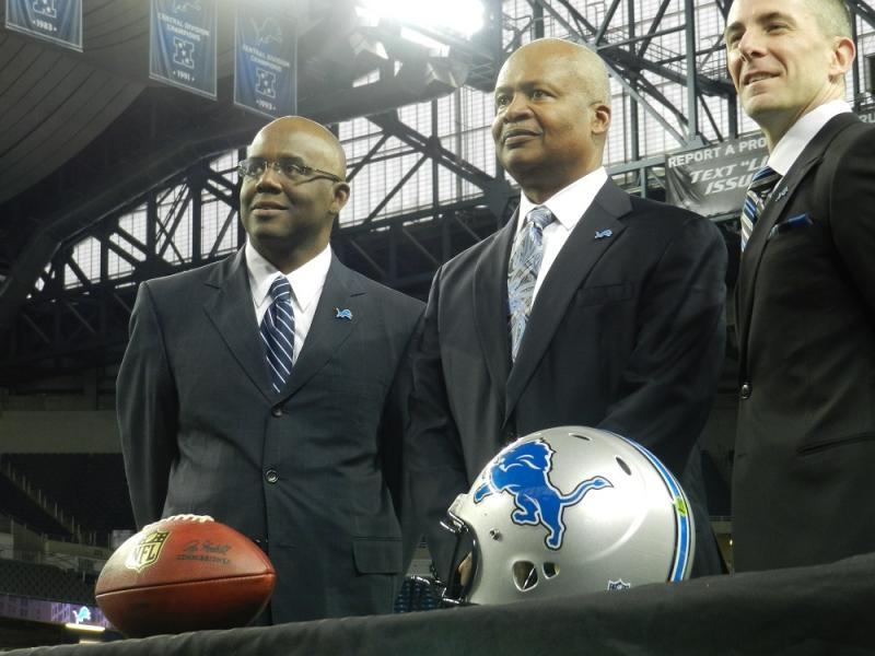 Detroit Lions head coach Jim Caldwell (center), flanked by Lions GM Martin Mayhew and Team President Tom Lewand