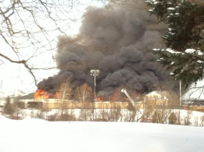 Smoke billows out of Fifth Third Ballpark north of Grand Rapids.