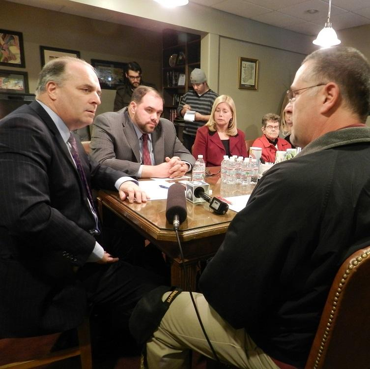 Congressman Dan Kildee (D-Flint) talks with several people who are among Michigan's long-term unemployed.  State Senator Jim Ananich (D-Flint) (center) listens.