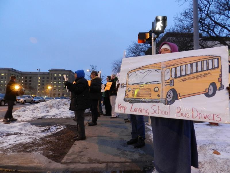 Dozens of Lansing school bus drivers and their supporters showed up at last night's school board meeting to oppose a plan to hire a private company to provide bus service to district students.
