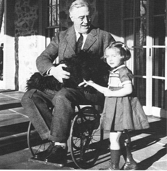 One of the few photographs of Franklin D. Roosevelt in a wheelchair. Taken at Top Cottage in February 1941.
