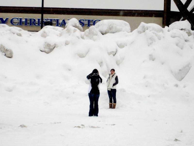 Snow piles up in a commercial parking lot in Grandville in January 2009.