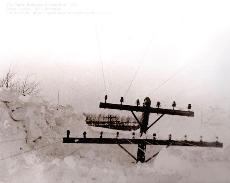 As meteorologist Karl Bohnak writes, it's hard to measure just how much snow accumulated in the blizzard of 1938 when snow piled up around utility poles. But we're guessing a lot.