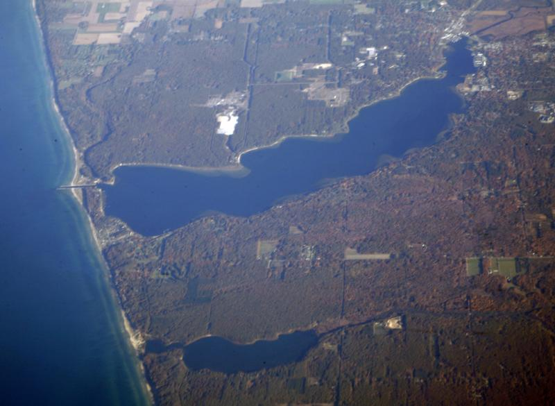 White Lake is the larger lake pictured. It lies north of Muskegon, Michigan.