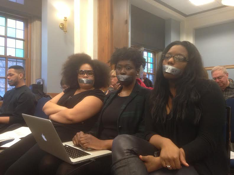 Three of the students at the Board of Regents meeting yesterday.