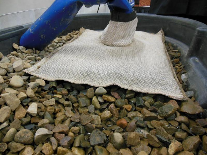 An example of a what a de-watering bag looks like. They put the sediment in the bags and then the water leaks out into the rocks below. The water is collected, treated and then put back into the river. The sediment in the bag is later hauled away.