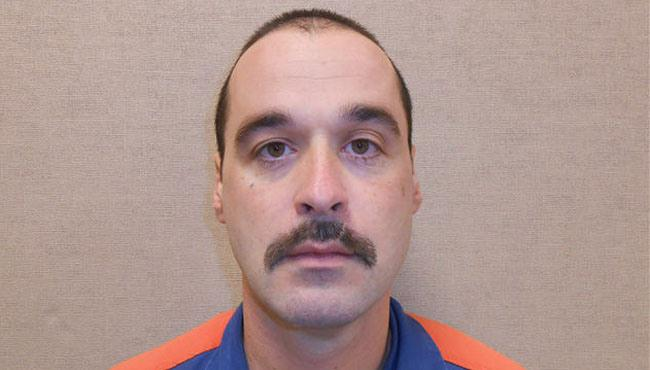 Michael Elliot was discovered missing Sunday during an inmate count at the Ionia Correctional Facility, 30 miles east of Grand Rapids. The 40-year-old was arrested Monday in northwestern Indiana, driving a stolen vehicle.