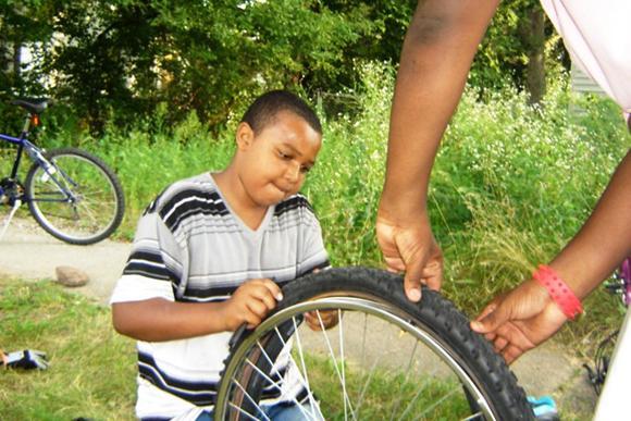 Repairing a bicycle.