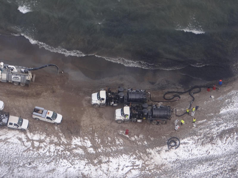 Clean-up crews on the shore of Lake Michigan near a BP refinery in Whiting, Ind.
