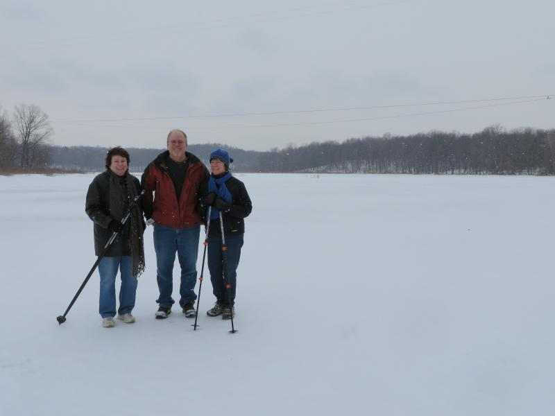 Mary Mandeville (L) and Tim and Mary Jane Eder on Island Lake. The proposed mine site is west of the lake.