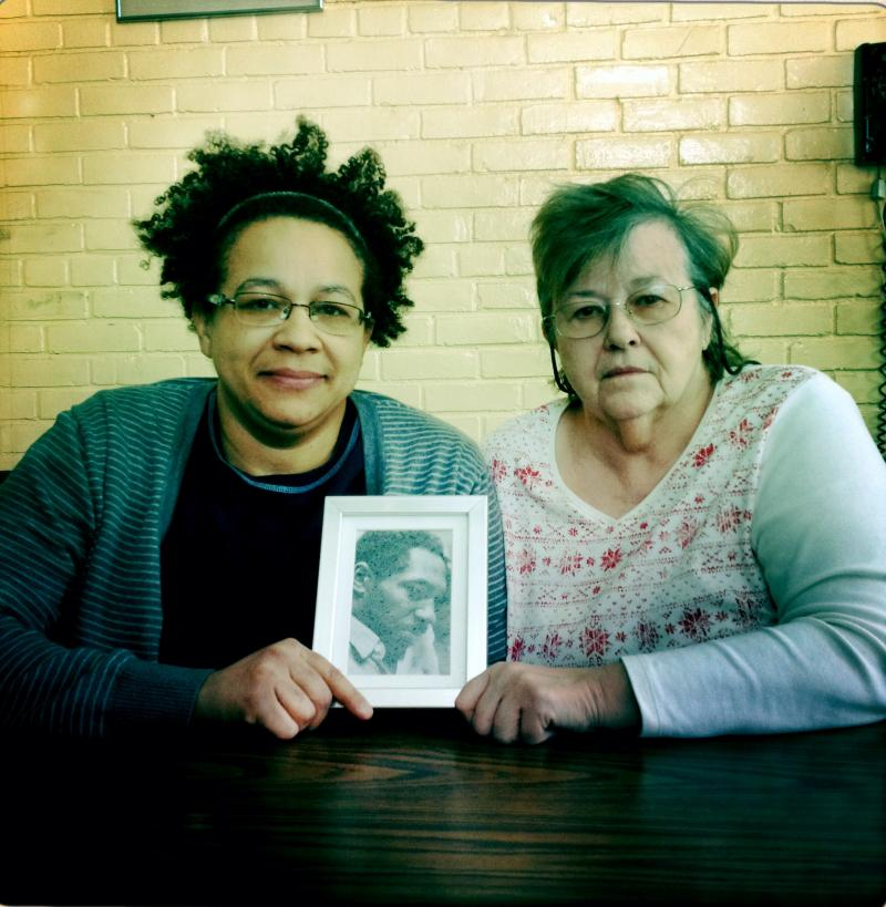 Tamara Kamara, Robinson's youngest child, and widow, Cheryl Buswell-Robinson.