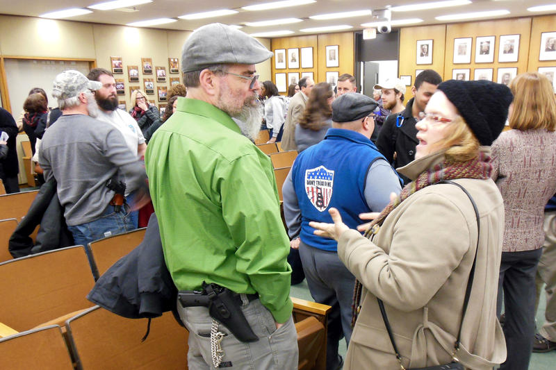 Gun rights advocates gathered at a Grand Rapids City Commission meeting earlier this week.