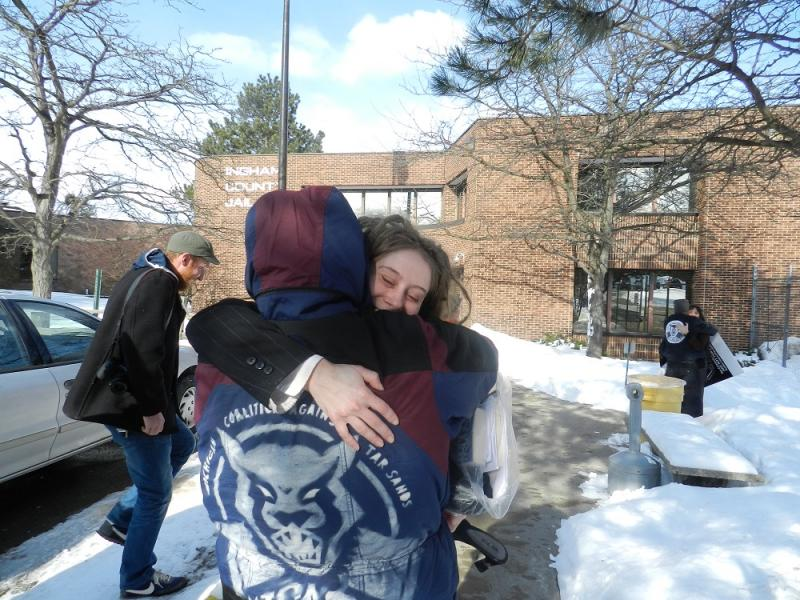 Protester Barbara Carter hugs a supporter after leaving the Ingham County jail.   She and her fellow defendents were sentenced to 13 months probation.
