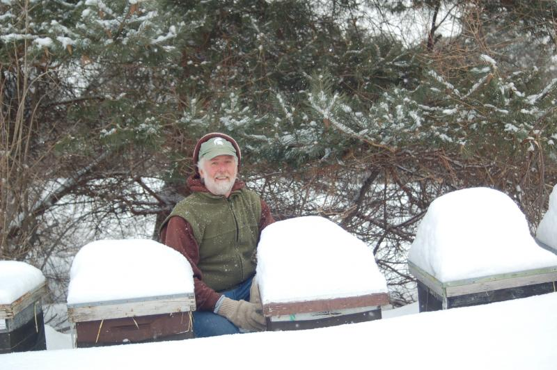 Greg Griswold with some of his bee boxes in Beulah, Michigan in March.
