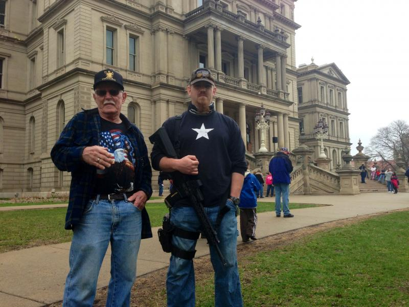 Jim Howley (left) and his son Josh Howley (right) at 2nd Amendment rally at the Michigan capitol today.
