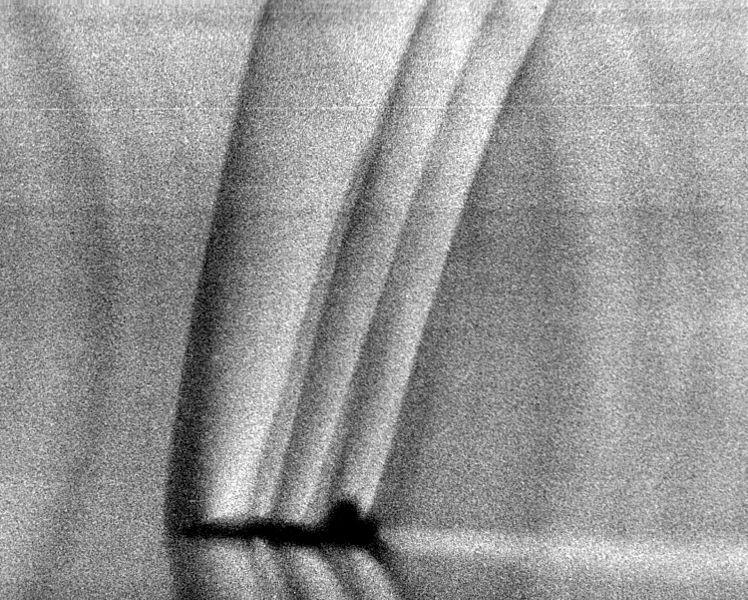 A picture that shows the shock waves around a T-38 Talon aircraft on December 13, 1993.