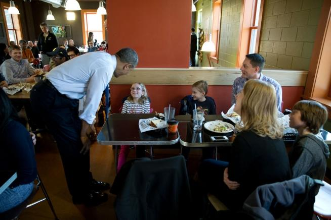 President Barack Obama visits with patrons during a stop for lunch at Zingerman's Delicatessen in Ann Arbor, Mich., April 2, 2014.
