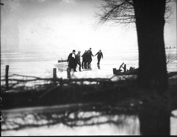 Rum-runners bring alcohol across the frozen Detroit River in sleds in 1930.