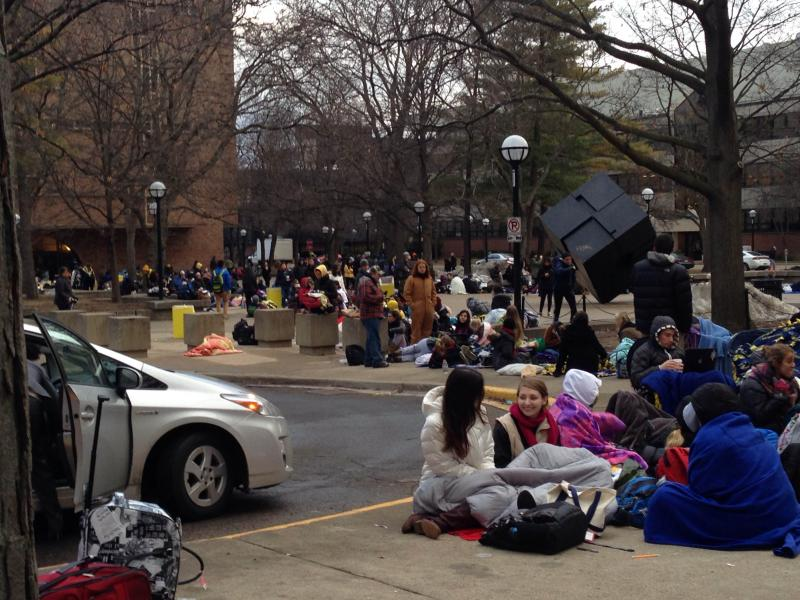 Students wait in line this morning for tickets to see President Obama speak.