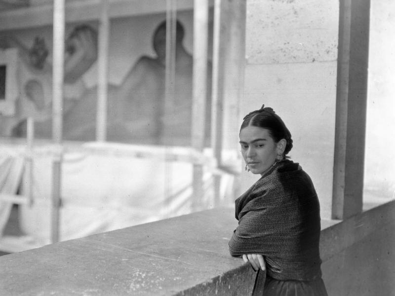 Frida Kahlo overlooking Rivera Court at the DIA circa 1932-33.