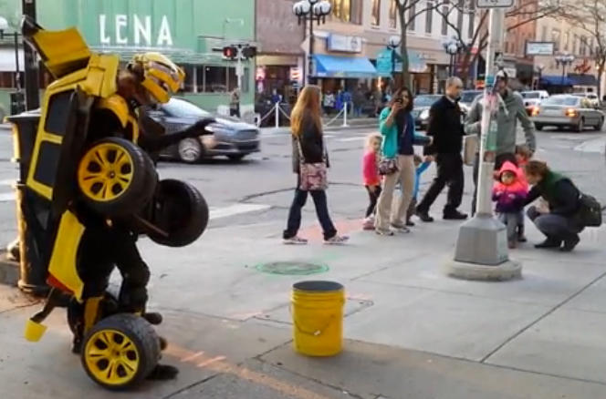"Car or human? This ""transformer"" street performer wants to reassure the kids he's human."