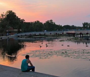 A young man (no relation to Andersen) sitting near Brighton Mill Pond. Was he whispering expletives under his breath too?