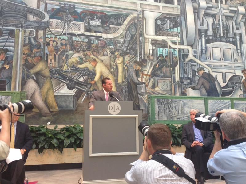Reid Bigland of Chrysler speaks at the media event announcing that U.S. automakers will contribute to the 'grand bargain.' Bigland is standing in front of one of the famous Diego River murals at the DIA.