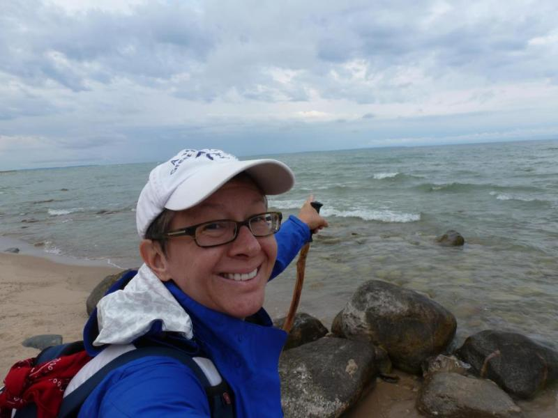 Loreen Niewenhuis at Manitou Passage (Lake Michigan) with the Manitou Islands visible offshore.