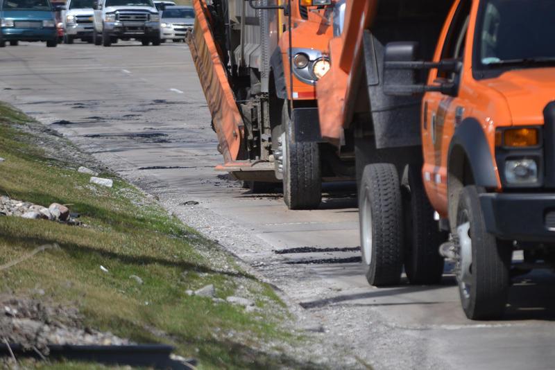 Repair trucks on a Michigan road.